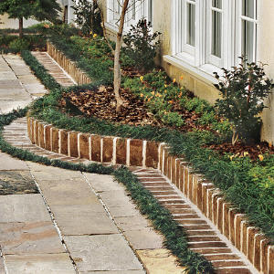 Design a Brick Border for a Garden Courtyard Southern Living