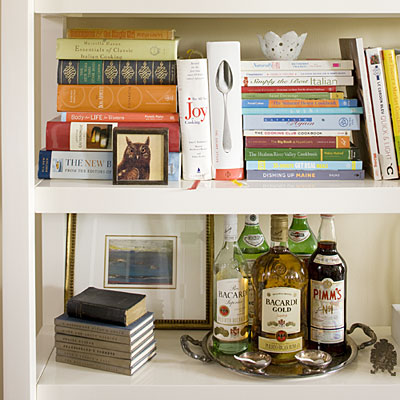 Artfully Arrange Bookshelves - 10 Apartment Decorating Lessons ...