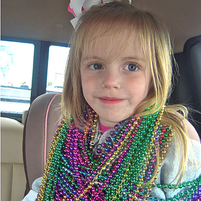 after attending her first mardi gras parade eastin 39 s beads weighed