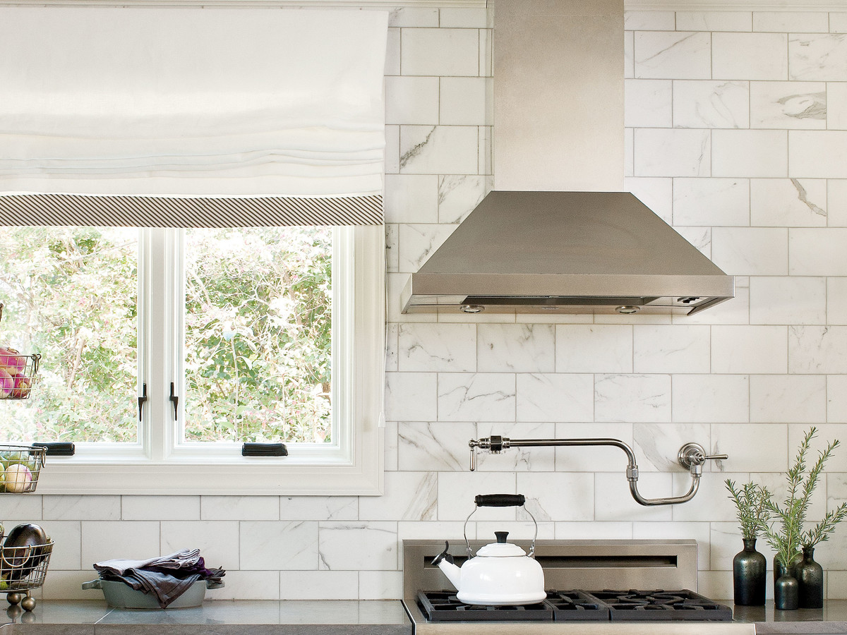 Thuston white kitchen with marble backsplash