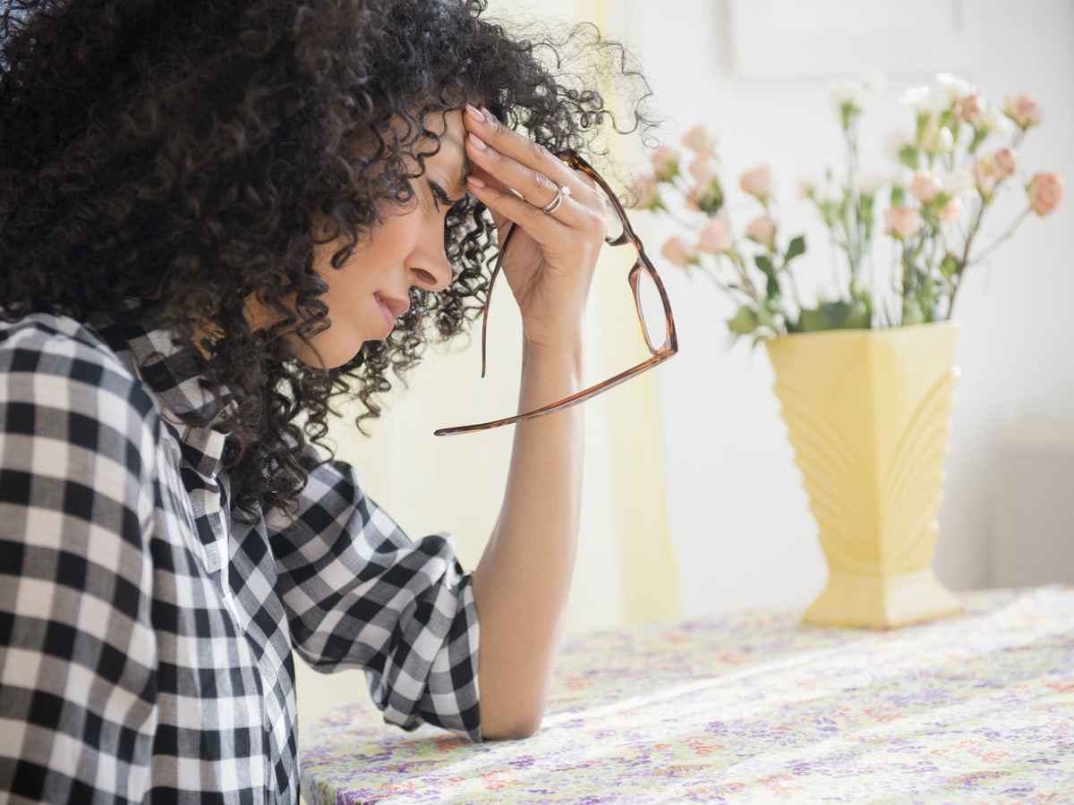 Worried Stressed Woman with Glasses