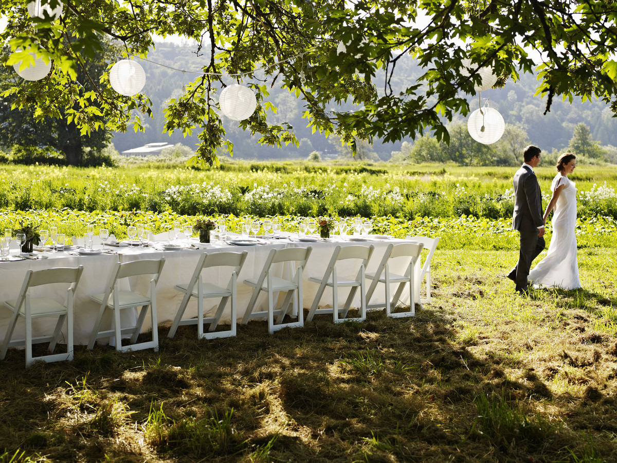 Outdoor Wedding with White Chairs