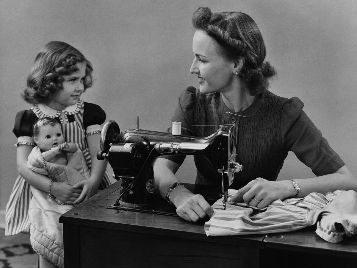 Mother at Sewing Machine with Daughter