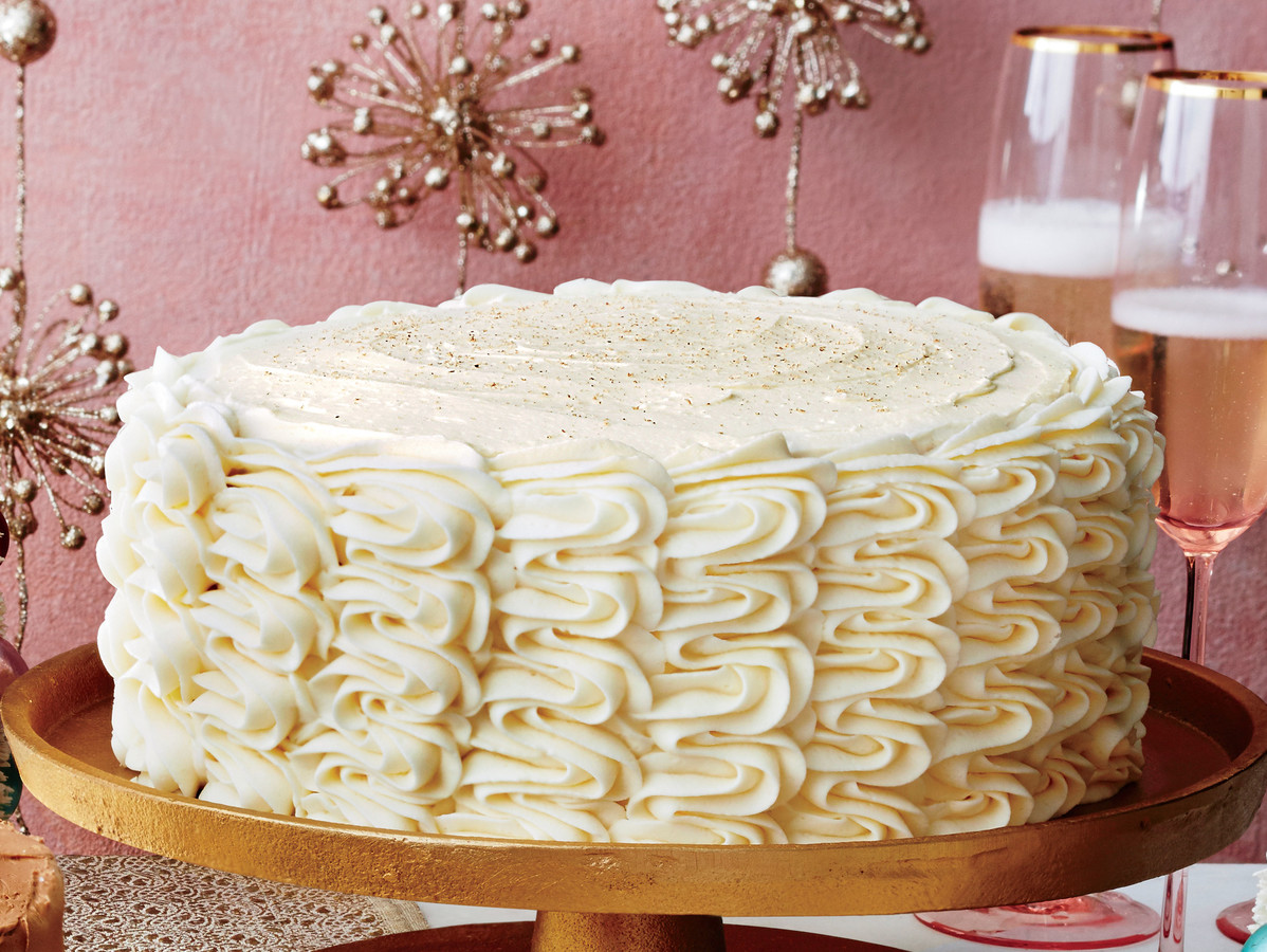 Eggnog Spice Cake with Bourbon Custard Filling and Eggnog Buttercream
