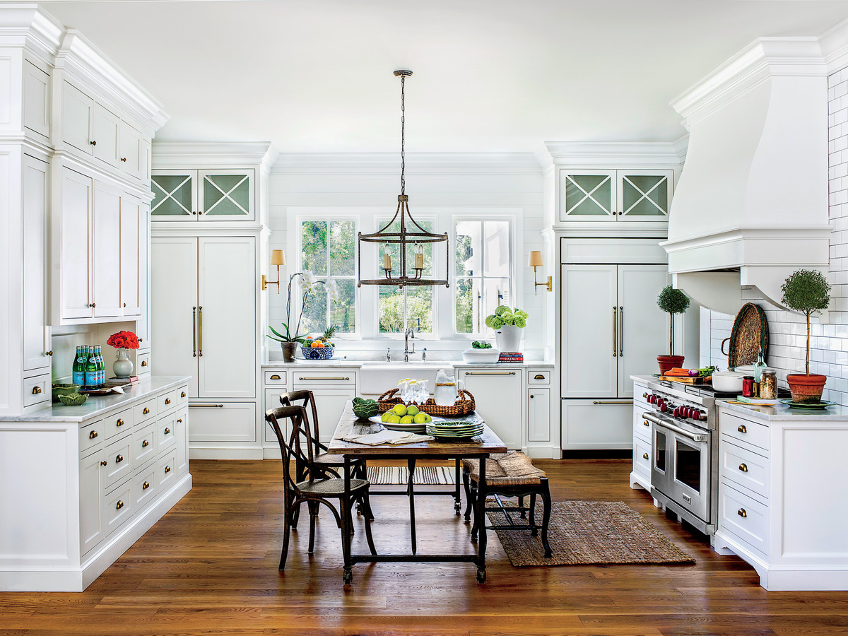 Large White Kitchen With Farm Table Island