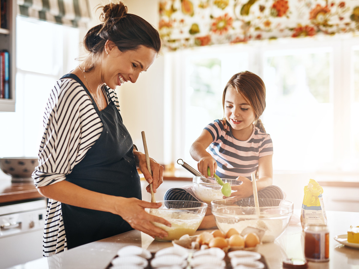 Mom Baking with Daughter Smiling