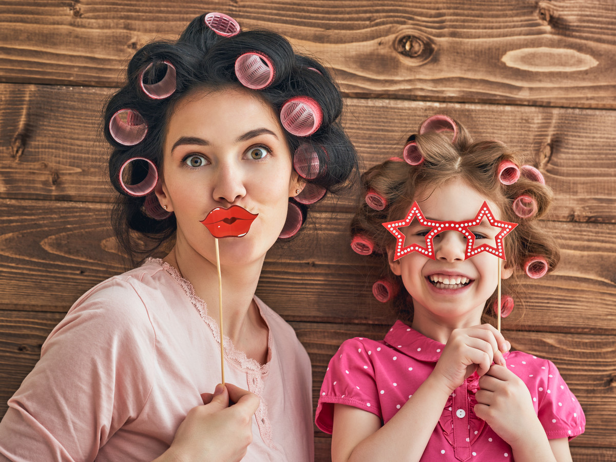 Mom and Daughter Wearing Hair Curlers and Joking
