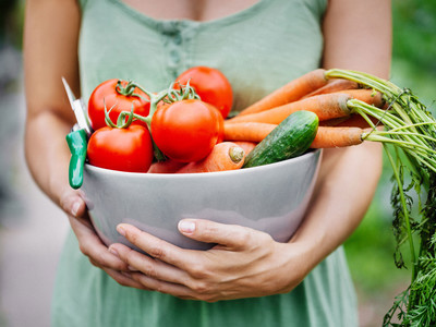 Getty Woman Holding Produce
