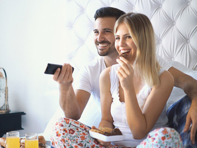Getty Man Woman Eating In Bed