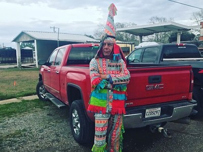 anthony bourdain wears crazy outfit to chase chickens in louisiana for mardi gras