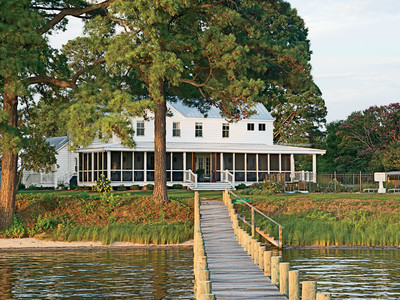 """It's a quiet, sleepy summer village. There's a long, winding road to get there, and by the time you pull up to the house, you're already chilled out,"" says designer Janie Molster of Fishing Bay, Virginia, where her clients' have a simple farmhouse retrea"