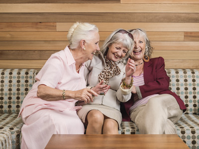 Three Woman Laughing on Couch