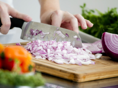 Chopping Red Onions on Cutting Board