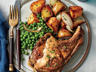 Fried Pork Chops with Peas and Potatoes