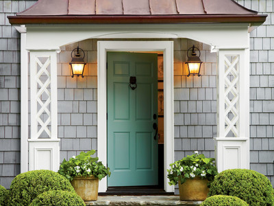 Teal Door on Gray House