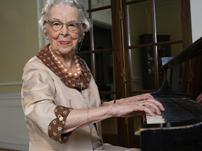 senior woman playing piano