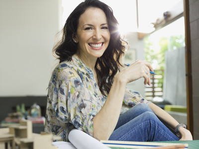 Woman Smiling in Home Office