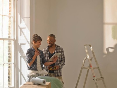 Couple Painting and Laughing