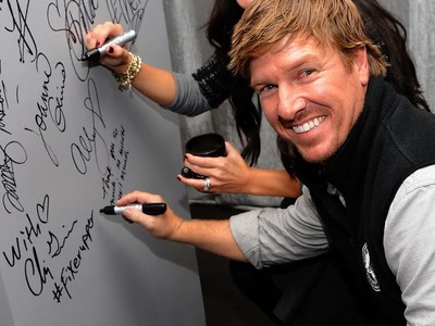 Chip Gaines Signing a Wall