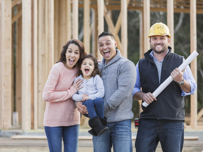 Contractor with Family at Building Site