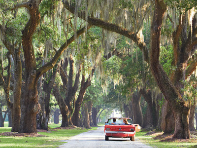 Couple Driving in Red Convertible Car Through the Lowcountry