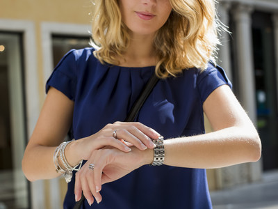 Blonde Woman Looking at Watch for Time