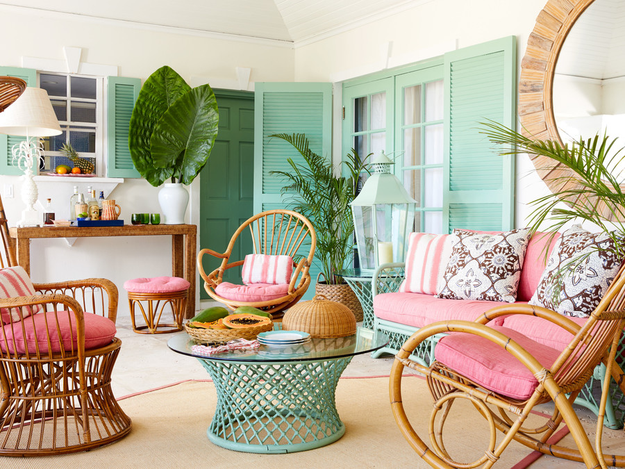 Lindroth enlivened the bamboo and rattan porch furniture that came with the house by painting the sofa and table bases to match the house trim, and then adding conch-shell pink cushions to all the seating. By situating the bar under the window,...