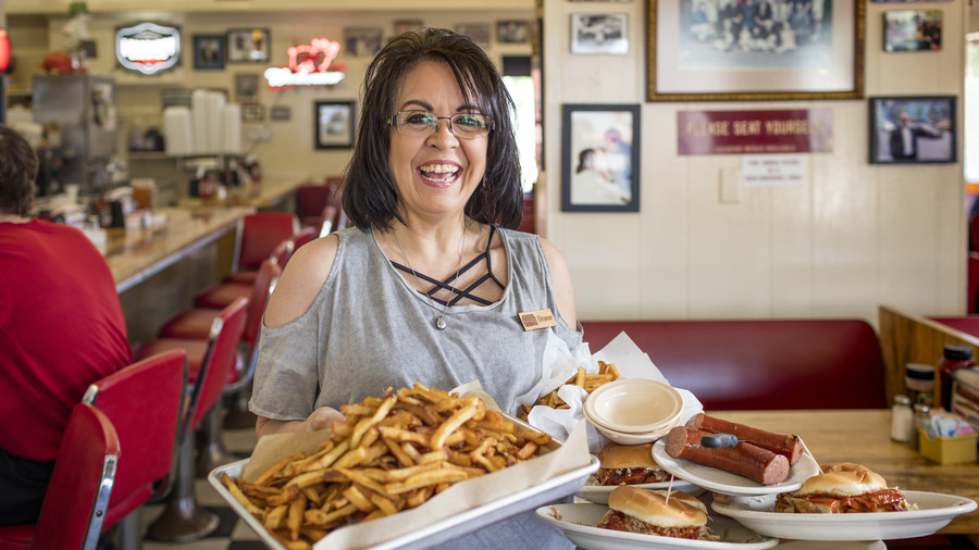 For Visit Hot SpringsMcClards BBQ  server Eleanor, long time employee.