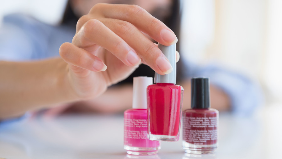 Woman Selecting Nail Polish