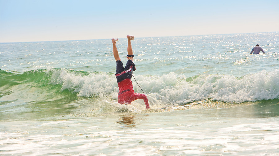 Mark McCann performs Headstand at WB Surf Camp