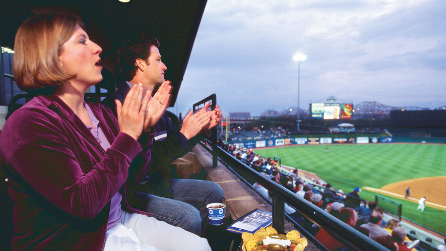 couple watching louisville bats game at slugger field