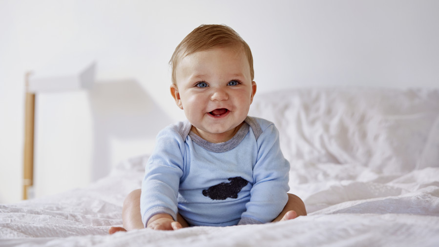Baby Boy Laughing on Bed