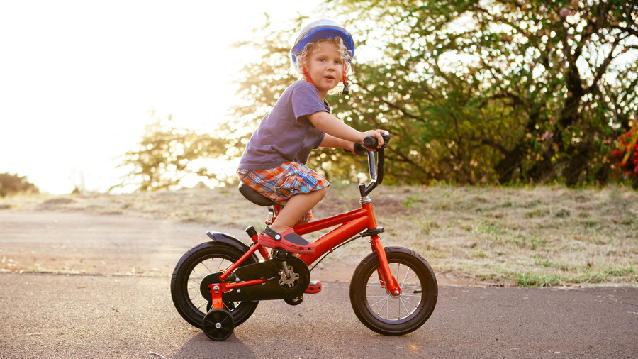 Toddler Riding Red Bike