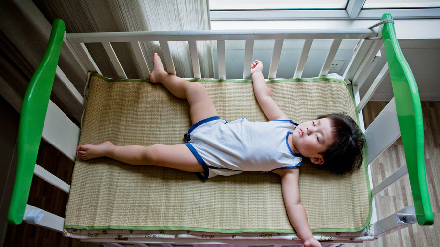 Toddler Boy Sleeping in Crib
