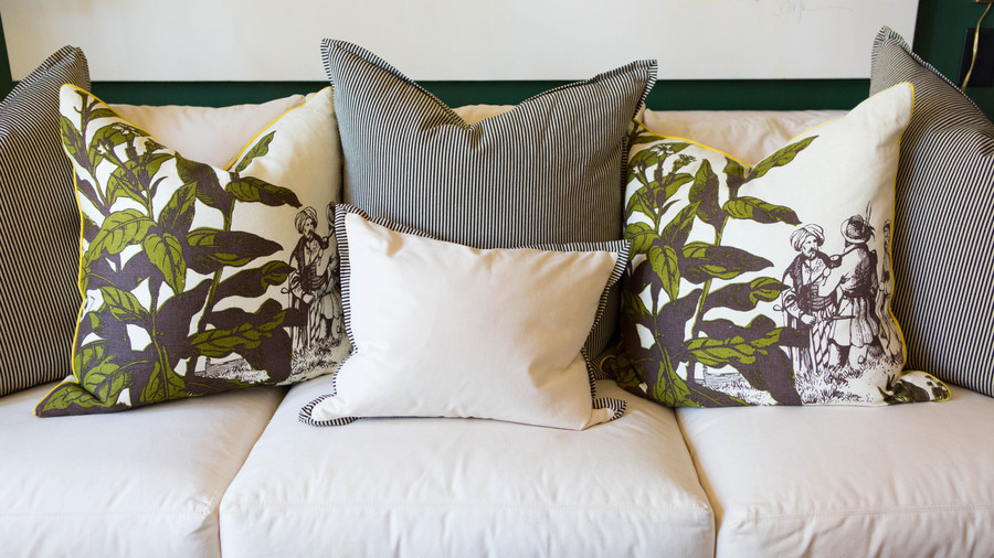 White couch with Floral Pillows
