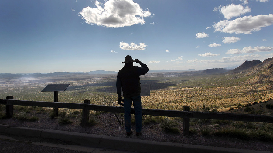 Rancher Looking at the Border