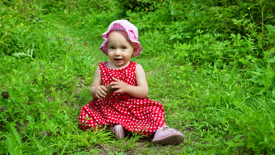 Baby Girl In The Grass