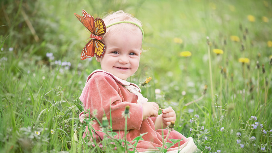 Little girl on a field of wild flowers