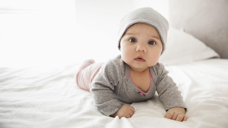 Baby in Gray PJs and Hat