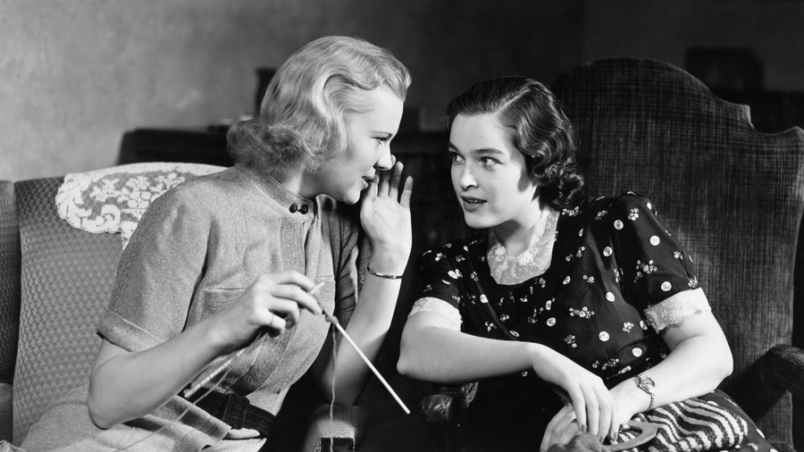 Two women talking while knitting