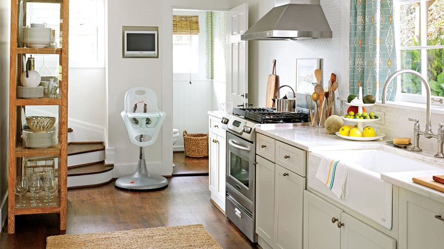 Tiny White Kitchen with Baby Chair