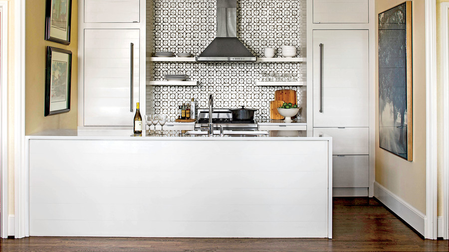 White Symmetrical Kitchen With Backsplash