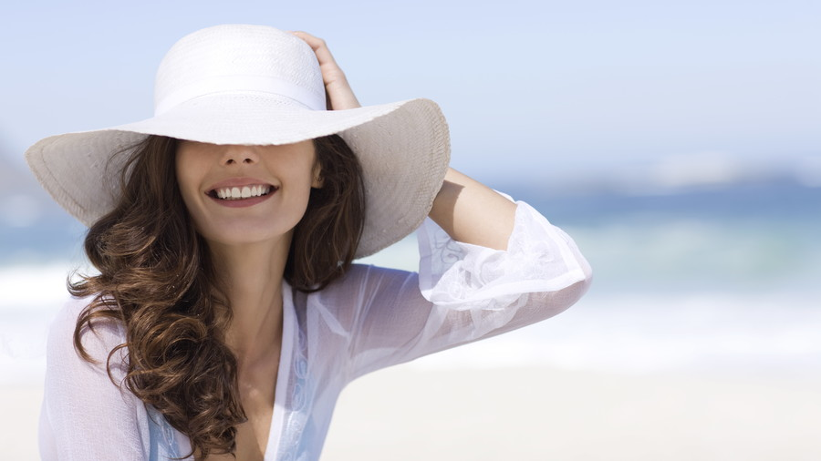 Throw on a wide-brimmed hat