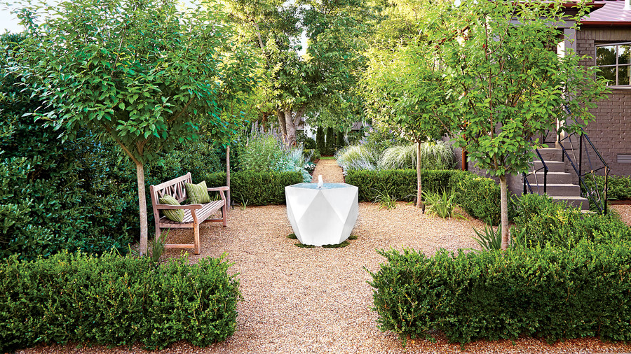Green and Gravel Yard with Fountain