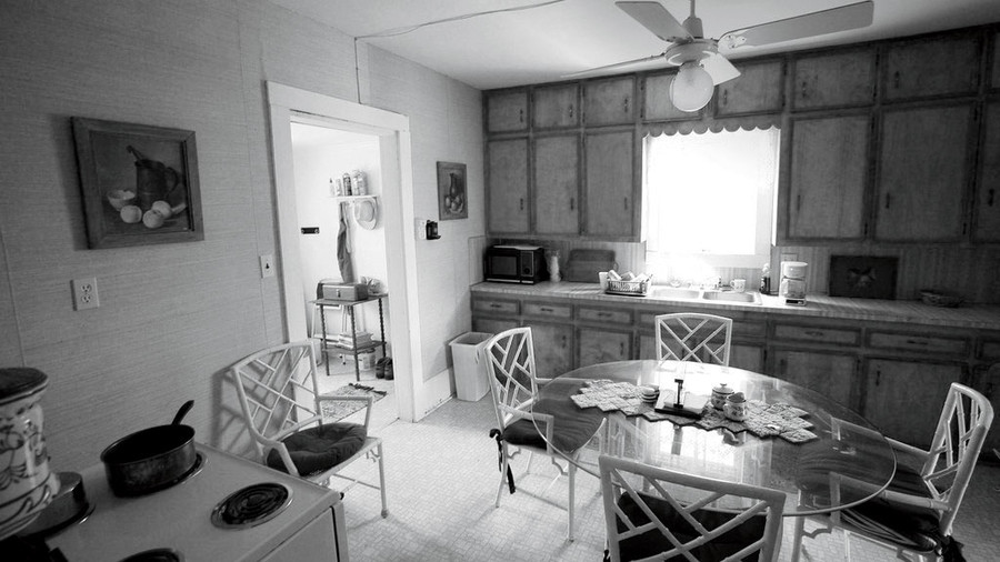 Outdated Kitchen with Cabinets and Glass Table