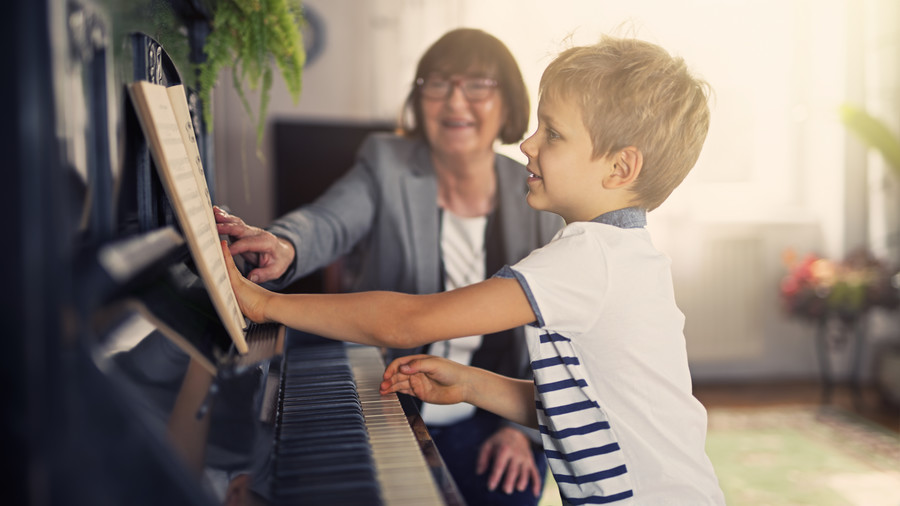 Woman Teaching Boy Piano