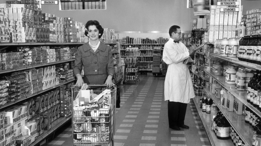 Woman with Grocery Cart in Aisle