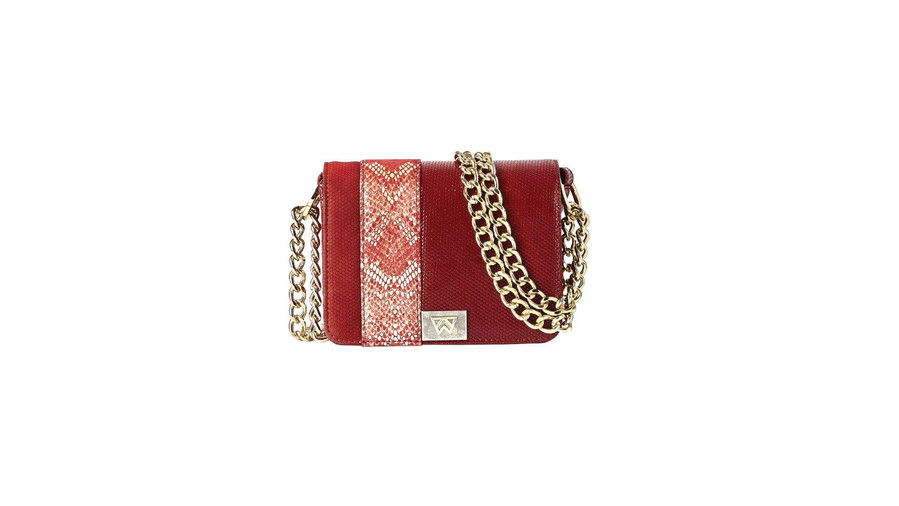 If being trendy won you touchdowns, we'd want this bag on our team. We can't get enough of the fiery red embossed suede or the snakeskin details. (P.s. This one was inspired by the designer's time at Ole Miss. Hotty Toddy, indeed.)