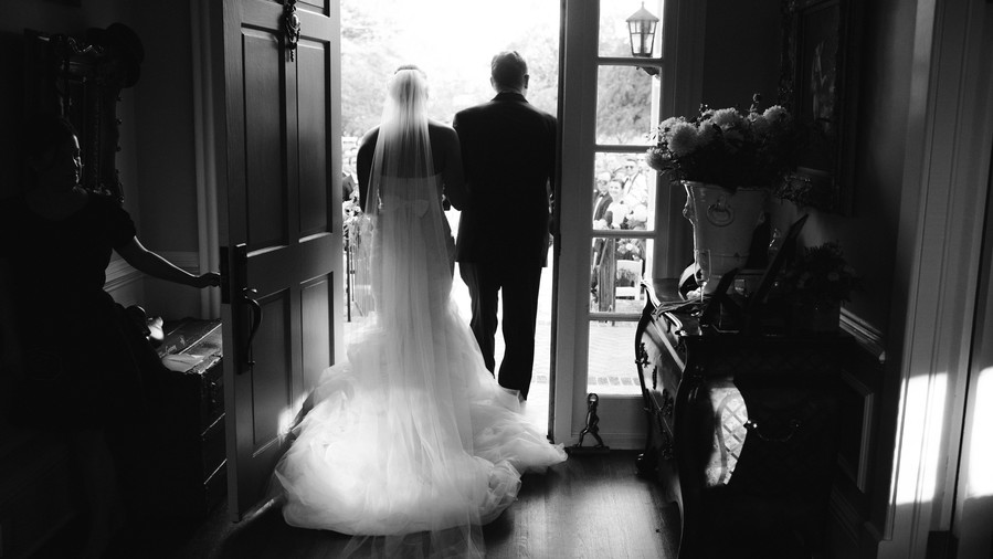 Bride and Father Walking Out Front Door