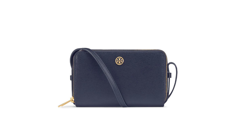 Talk about wiggle room. Two zippered compartments mean you can pack a lot into this bitty cross-body. Plus, the classic navy hue will carry you far beyond football season. (It also comes in camel and hot-hot pink.)